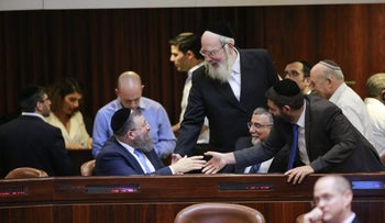 MK Israel Eichler and members of ultra-Orthodox Shas party in the Knesset on December 25, 2017.