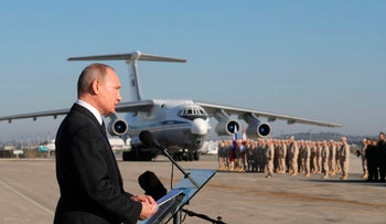FILE PHOTO: Russian President Vladimir Putin addresses the troops at the Hemeimeem air base in Syria on Tuesday, Dec. 12, 2017.