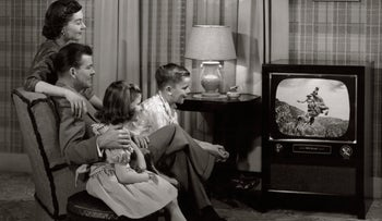 A 1950s family watches television.