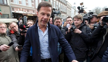 Dutch Prime Minister Mark Rutte gestures during a campaign stop in Breda, Netherlands, March 11, 2017.