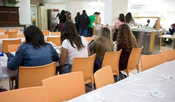 Youths in the cafeteria of a boarding school for children at risk in Netanya, March 29, 2017.