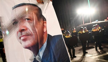 A large image of Turkish President Recep Tayyip Erdogan placed outside the Turkish consulate during protests in Rotterdam, Netherlands, March 11, 2017.