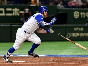Israeli right fielder Zach Borenstein hits a one-run single at the top of the sixth inning during the World Baseball Classic Pool E second round match between Cuba and Israel at Tokyo Dome in Tokyo on March 12, 2017.