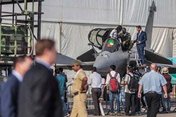 File Photo: Attendees gather around a Rafale ominirole fighter jet during the Aero India air show in Bengaluru, India, on Thursday, Feb. 19, 2015.