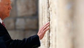 Trump reaches out to touch the Western Wall, May 22, 2017, in Jerusalem.