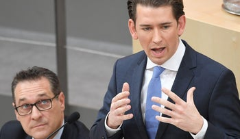 Austrian Chancellor Sebastian Kurz speaking in the Austrian parliament as the leader of the far-right Freedom Party, Heinz-Christian Strache looks on.