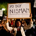 """A demonstrator holds a sign that reads """"I am Nisman"""" during a protest after the death of Alberto Nisman, Buenos Aires, Argentina, January 19, 2015."""