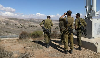 Israeli forces are seen near a border fence between the Israeli Golan Heights and Syria, November 4, 2017.
