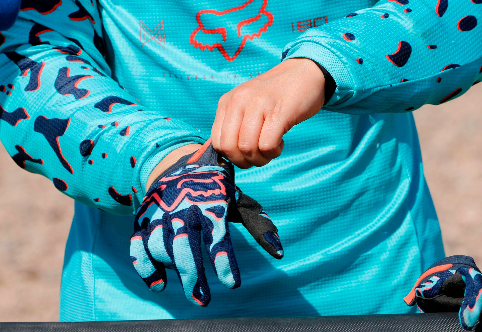 Iranian motorbike champion Behnaz Shafiei adjusts her gloves during a training session in Parand, southwest of Tehran, on February 27, 2017.