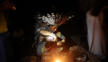 File photo: A Huni Kui Indian prepares a drink known as nixi pae or ayahuasca to use in a healing ritual in the village of Novo Segredo along the Envira river of Brazil's northwestern Acre state.