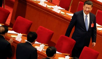 China's President Xi Jinping arrives for the third plenary session of the National People's Congress (NPC) at the Great Hall of the People in Beijing, China, March 12, 2017.