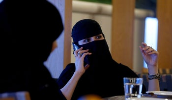 FILE PHOTO: A woman speaks on a mobile phone in a cafe in Riyadh, Saudi Arabia October 6, 2016