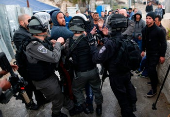 Israeli security forces clashing with Palestinians next to the memorial tent erected for Ibrahim Mattar, the assailant shot by Border Police officers he had stabbed, March 13, 2017.