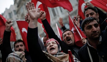 A group of Turks protest outside the Dutch consulate in Istanbul, Turkey, March 12, 2017.