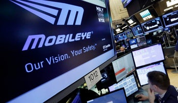 The Mobileye logo appearing on a screen at the post where it trades on the floor of the New York Stock Exchange, Monday, March 13, 2017.