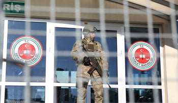 A Turkish army soldier stands guard at the trial of the the alleged New Year's Eve shooter, Dec 11, 2017