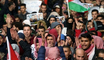 Palestinians take part in a protest against the Palestinian Authority in the West Bank city of Ramallah, March 13, 2017.