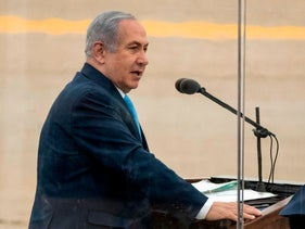 Israeli Prime Minister Benjamin Netanyahu delivers a speech during the graduation ceremony of Israeli air force pilots in the Negev desert on December 27, 2017.