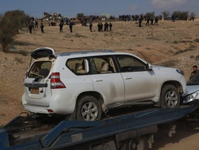 Al-Kiyan's car being towed from the scene in Umm al-Hiran