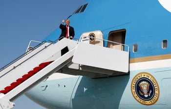 U.S. President Donald Trump arrives on Air Force One in West Palm Beach, Florida on December 22, 2017.