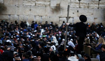 Religious Jews attend a special prayer service for rain at the Western Wall in Jerusalem's Old City on December 28, 2017.