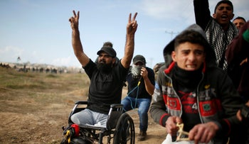 Wheelchair-bound Palestinian demonstrator Ibrahim Abu Thuraya gestures during a protest against Trump's recognition of Jerusalem as Israel's capital, Gaza, December 15, 2017.