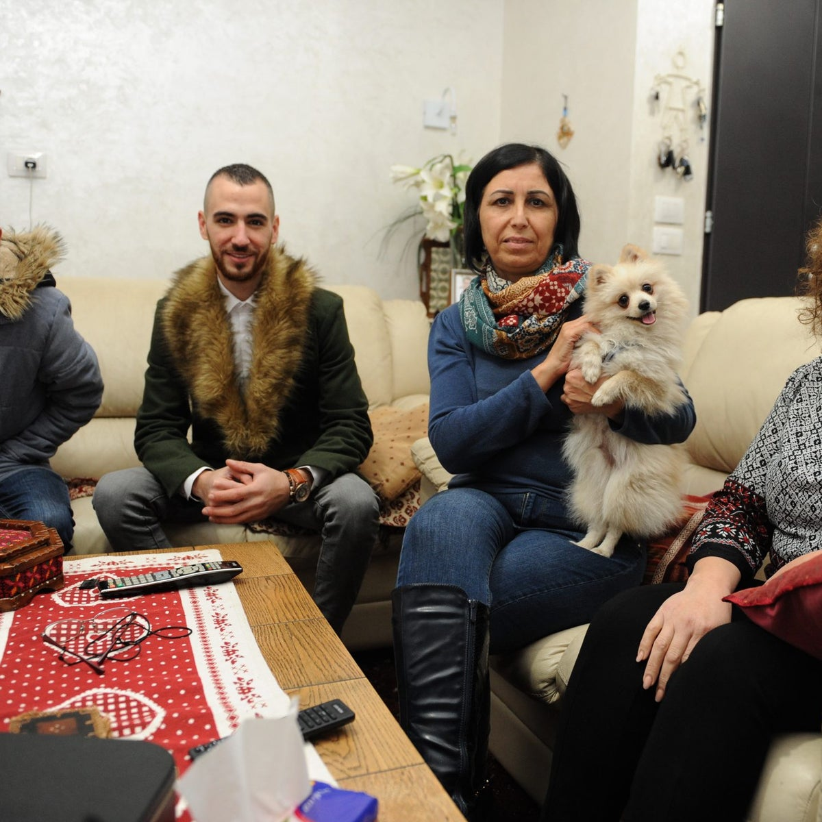 Members of the Abad family and their dog Gucci, Nazareth, December 27, 2017.