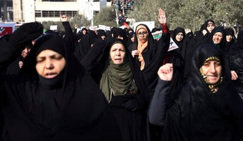 Iranian protesters chant slogans at a rally in Tehran, Iran, Saturday, Dec. 30, 2017.