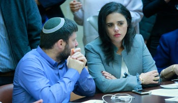 Justice Minister Ayelet Shaked of Habayit Hayehudi speaks with fellow party member Bezalel Smotrich, December 25, 2017.
