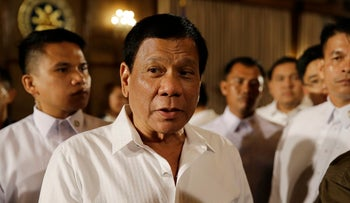 Philippine President Rodrigo Duterte is surrounded by security after a press conference in Manila, Philippines, March 13, 2017.