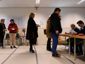 People queue at a polling station for Dutch general elections in The Hague, March 15, 2017.