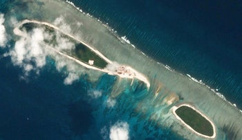 Satellite photos show Chinese-controlled North Island, part of the Paracel Islands group in the South China Sea, Feb. 15, 2017 and March 6, 2017.