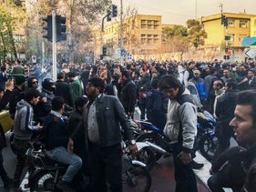 In this photo taken by an individual not employed by the AP and obtained outside Iran, demonstrators gather to protest against Iran's weak economy, Tehran, Iran, Saturday, December 30, 2017.