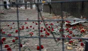 File photo: Carnations at a security barrier in Dyarbakir, Turkey, November 2017.