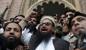 Hafiz Saeed, head of Jamaat-ud-Dawa, gestures outside a court in Lahore, Pakistan, November 22, 2017.