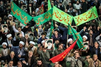 Iranians chant slogans as they march in support of the government near the Imam Khomeini grand mosque in the capital Tehran on December 30, 2017.