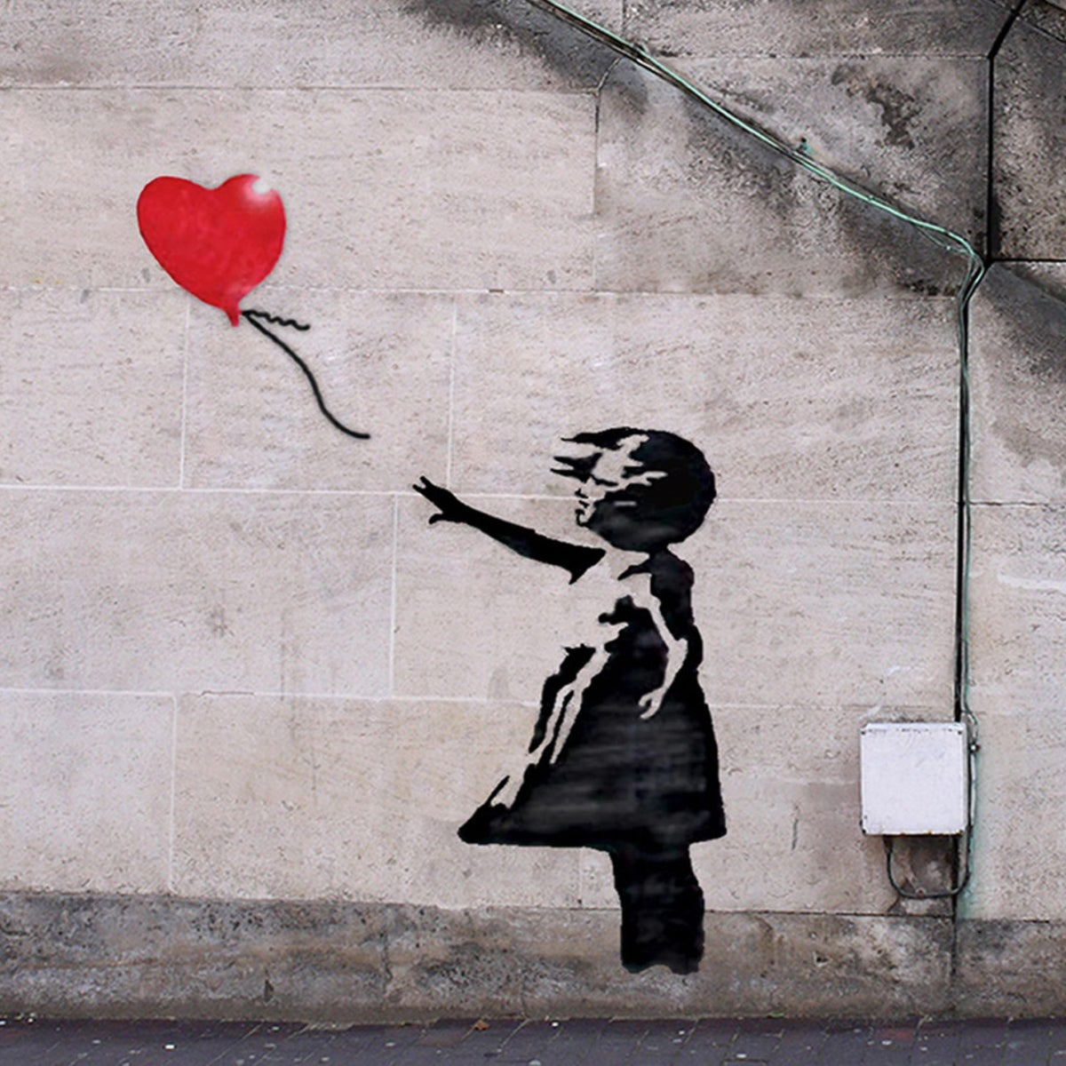 """""""Girl With a Balloon"""" by Banksy."""