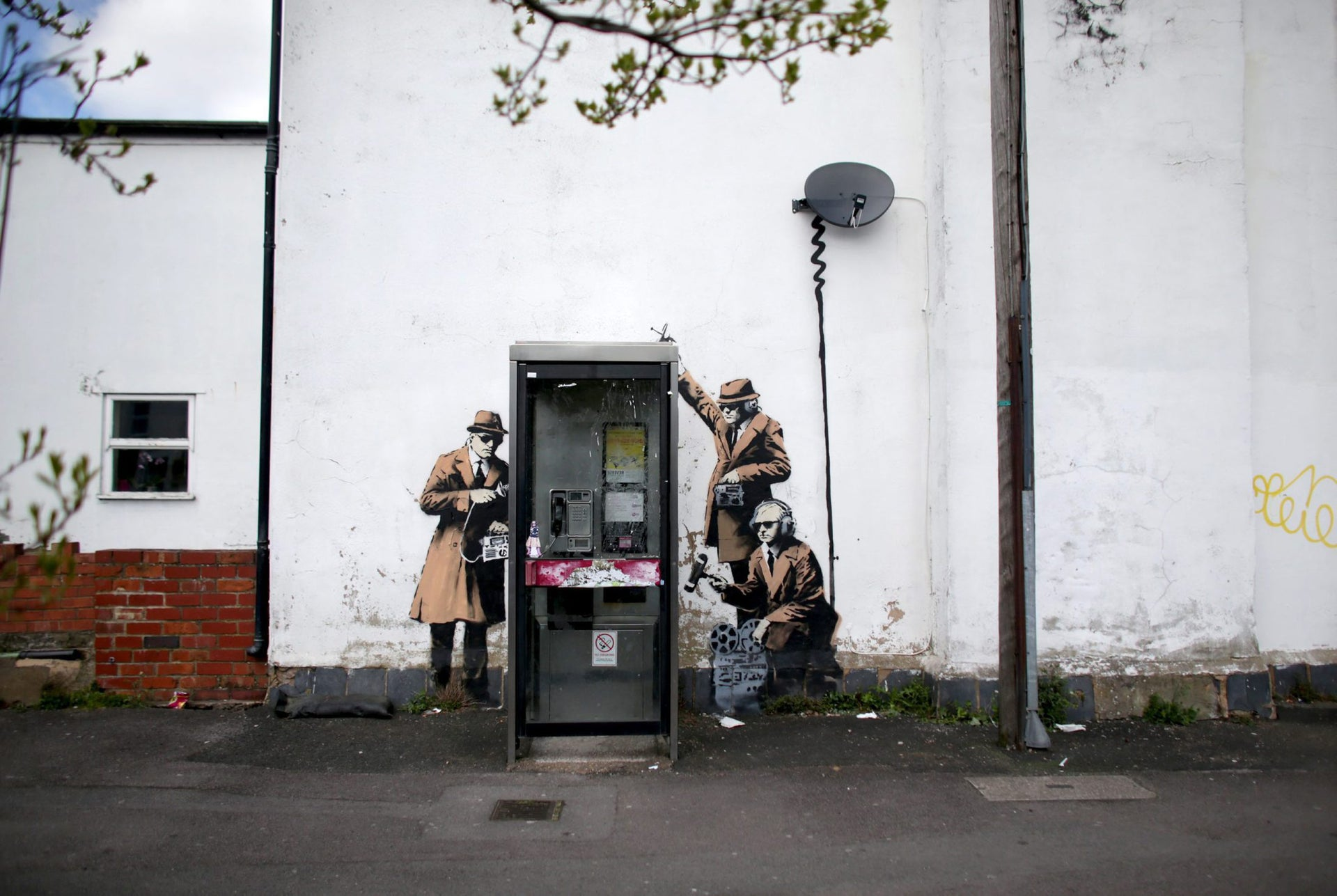 A piece of new graffiti street art, claimed to be by Banksy, that appeared on the side of a house in Cheltenham, England, April 14, 2014.