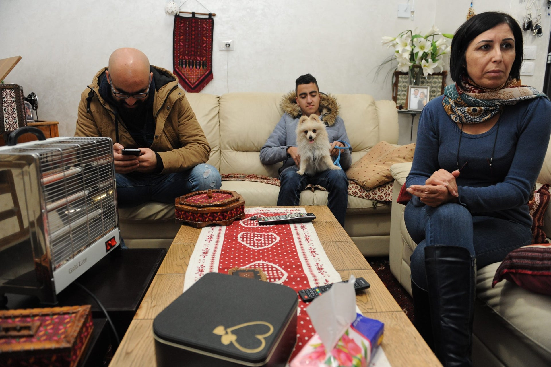 Members of the Abad familywith their dog Gucci at home in Nazareth.