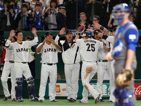 Team Japan celebrates after scoring against Team Israel in the World Baseball Classic, March 15, 2017.