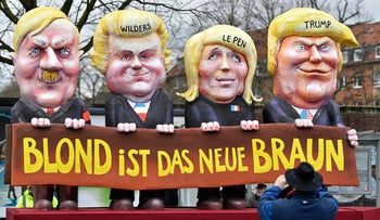 A carnival float depicting U.S. president Donald Trump with Marine Le Pen, Geert Wilders and Adolf Hitler reads 'blonde is the new brown.'
