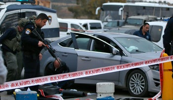 Security forces at the scene of an attempted car-ramming attack at the Gush Etzion junction in the West Bank, March 15, 2016.