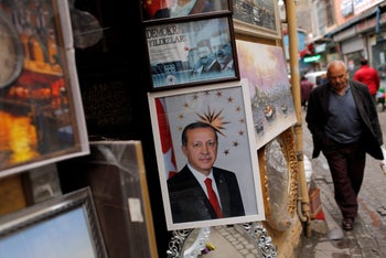 A poster of Turkish President Tayyip Erdogan is seen outside of a framing shop in Istanbul, Turkey March 15, 2017.