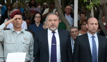 Defense Minister Avigdor Lieberman and Education Minister Naftali Bennett at a memorial service for soldiers who fell in the Second Lebanon War, June 9, 2016.