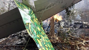 Fire at the site where a plane crashed in Costa Rica, December 31, 2017 in this picture obtained from social media.