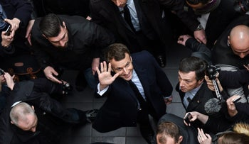 French presidential election candidate for the En Marche ! movement Emmanuel Macron waves on March 14, 2017 as he arrives at Lille's university, France, to give a conference focused on justice.