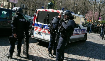 French police officers take position after letter bomb exploded at the French office of the International Monetary Fund, lightly injuring one person, Thursday March 16, 2017. A police official said no other damage was been reported in the incident.