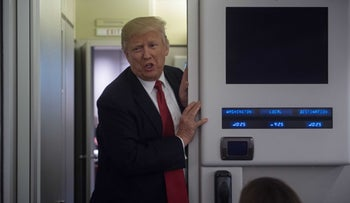US President Donald Trump speaks to reporters aboard Air Force One on March 15, 2017.