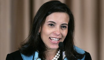 In this photo taken Jan. 6, 2006 Dina Powell speaks at the State Department in Washington.