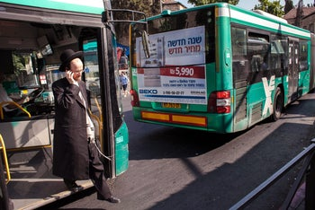 An ultra-Orthodox man alighting from a bus in Jerusalem. The High Court ruled in 2011 that gender segregation on buses was illegal without passengers' consent.